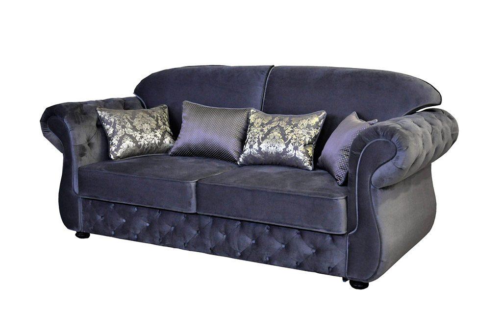 синий мягкий диван с подушками